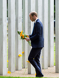 © Licensed to London News Pictures. 07/07/2015. London, UK. PRINCE WILLIAM laying flowers at the memorial during the service. A memorial service in Hyde Park London on the 10th anniversary of the 7/7 bombings in London. The event is attended by Prince William, survivors of the attack and family of those who lost their lives. Photo credit: Ben Cawthra/LNP