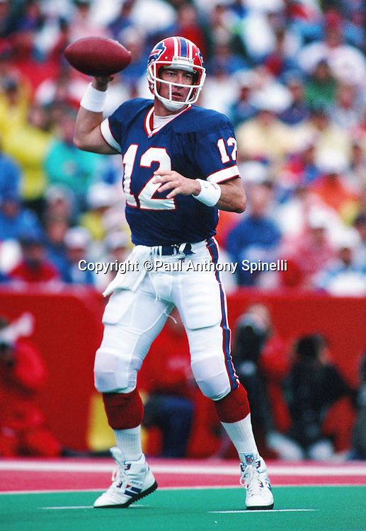 Buffalo Bills quarterback Jim Kelly (12) throws a pass during the NFL football game against the Miami Dolphins on Sept. 26, 1993 in Orchard Park, N.Y. The Dolphins won the game 22-13. (©Paul Anthony Spinelli)