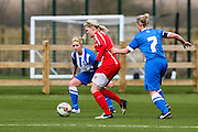 Cardiff's Michelle Green takes the ball past Kirsty Barton during the FA Women's Premier League match between Brighton Ladies and Cardiff City Ladies at Brighton's Training Ground, Lancing, United Kingdom on 22 March 2015. Photo by Geoff Penn.