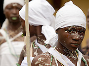 Young girls from the Krobo tribal group line up as they prepare to walk to a local shrine during the puberty rites - locally called dipo - held in Somanya, Eastern Region, Ghana.