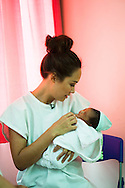 Myleene Klass, a high profile UK celebrity, TV host, violinist and pianist, holds Hans, Arlene's 1 day old baby, who has been breastfed since birth, in the Florencio V. Memorial Hospital in Paranaque city, Metro Manila, The Philippines on 19 January 2013. Photo by Suzanne Lee for Save the Children UK