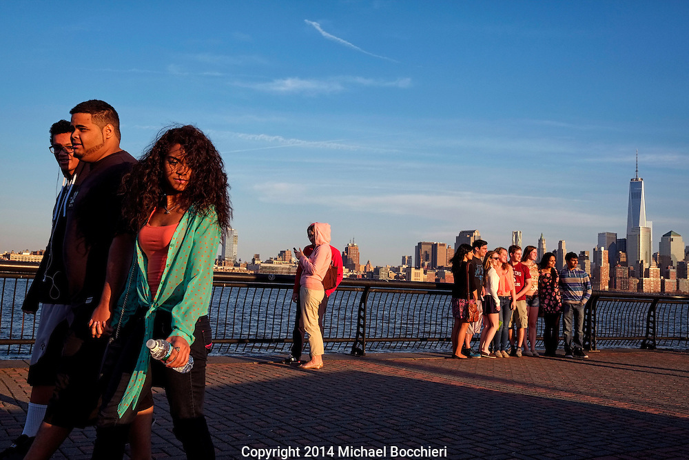 HOBOKEN, NJ - April 12:  People walk along the Hudson River in Pier A Park on April 12, 2014 in HOBOKEN, NJ.  (Photo by Michael Bocchieri/Bocchieri Archive)