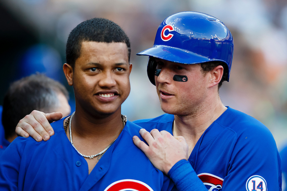 Jun 10, 2015; Detroit, MI, USA; Chicago Cubs left fielder Chris Coghlan, right,  receives congratulations from shortstop Starlin Castro after scoring in the second inning against the Detroit Tigers at Comerica Park. Mandatory Credit: Rick Osentoski-USA TODAY Sports