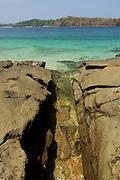 Sea waters entering between rocks in Contadora island shore. Las Perlas archipelago, Panama province, Panama, Central America.