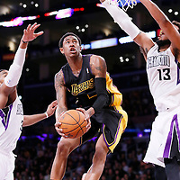 28 February 2014: Los Angeles Lakers shooting guard MarShon Brooks (2) goes for the layup past Sacramento Kings power forward Derrick Williams (13) during the Los Angeles Lakers 126-122 victory over the Sacramento Kings at the Staples Center, Los Angeles, California, USA.