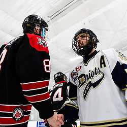 TORONTO, ON - APR 10, 2018: Ontario Junior Hockey League, South West Conference Championship Series. Game seven of the best of seven series between the Georgetown Raiders and the Toronto Patriots, Derek McVey #8 of the Georgetown Raiders and Nick Kalpousos #77 of the Toronto Patriots shake hands after the final whistle.<br /> (Photo by Kevin Raposo / OJHL Images)