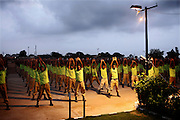 Recruits of the the Shaheed Benazir Bhutto Elite Police Training Center, a commando and anti-terrorism academy on the outskirts of Karachi, are exercising at dawn. The training center was founded by retired colonel Abdul Wahid Khan, a brave officer who served as a gunship helicopter pilot in the Pakistani Air Force and around the globe with the United Nations, but who's first task as a young army officer in 1979 was to train Afghan Mujahedeen to fight the Soviet Army, the very Mujahedeen that are today's Taleban.