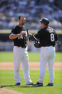 CHICAGO - AUGUST 14:  Paul Konerko #14 of the Chicago White Sox talks with third base coach Jeff Cox #6 during the game against the Kansas City Royals at U.S. Cellular Field in Chicago, Illinois on August 14, 2008.  The White Sox defeated the Royals 9-2.  (Photo by Ron Vesely)