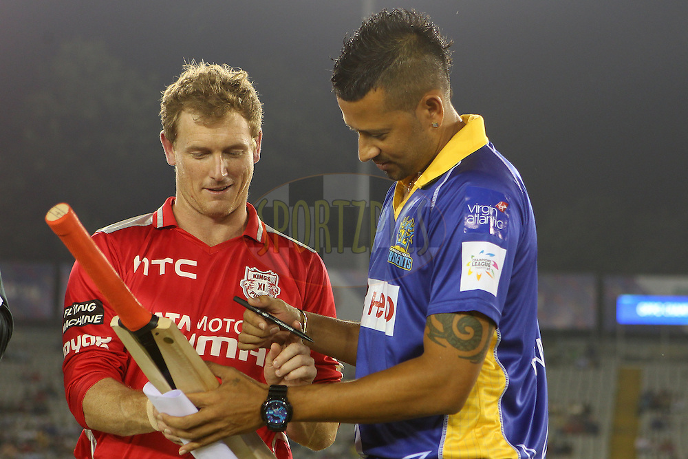 George BAILEY (Captain) of the Kings XI Punjab  and Rayad EMRIT (Captain) with the MCC Bat at the toss during match 5 of the Oppo Champions League Twenty20 between the Kings XI Punjab and the Barbados Tridents held at the Punjab Cricket Association Stadium, Mohali, India on the 20th September 2014<br /> <br /> Photo by:  Ron Gaunt / Sportzpics/ CLT20<br /> <br /> <br /> Image use is subject to the terms and conditions as laid out by the BCCI/ CLT20.  The terms and conditions can be downloaded here:<br /> <br /> http://sportzpics.photoshelter.com/gallery/CLT20-Image-Terms-and-Conditions-2014/G0000IfNJn535VPU/C0000QhhKadWcjYs