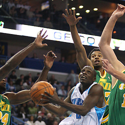 Feb 17, 2010; New Orleans, LA, USA; New Orleans Hornets guard Darren Collison (2) shoots between Utah Jazz defenders Paul Millsap (24) and Ronnie Price (17) and Mehmet Okur (13) during the first quarter at the New Orleans Arena. Mandatory Credit: Derick E. Hingle-US PRESSWIRE