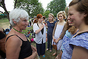 Jesuitenwiese, Vienna. Heidi Achter, Midwife meets some of the children she helped to be born during a festive picknick at the Prater.