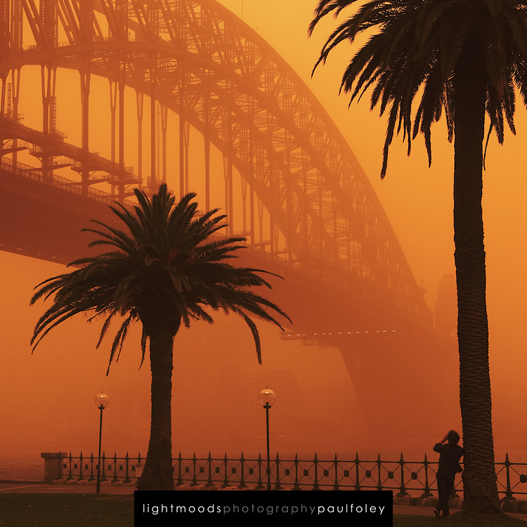Man Photographing the Sydney Harbour Bridge during dust storm, September 23, 2009. The Dust storm was caused by gale force winds blowing in from the drought stricken inland. The storm was dewscribed as being the worst in 70 years.