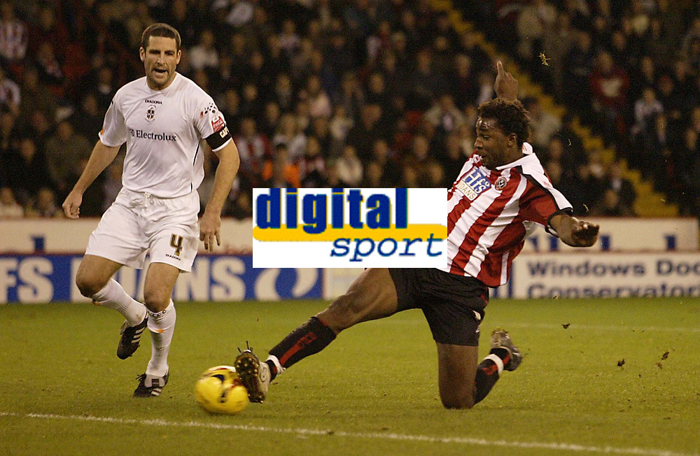 Photo: Aidan Ellis.<br /> Sheffield Utd v Luton Town. Coca Cola Championship.<br /> 01/11/2005.<br /> Sheffield's Vincent Pericard slides in to score the third goal