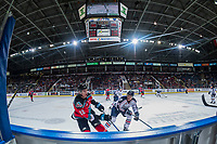 KELOWNA, CANADA - OCTOBER 27: Braydyn Chizen #22 of the Kelowna Rockets passes the puck away from Brett Clayton #24 of the Tri-City Americans on October 27, 2017 at Prospera Place in Kelowna, British Columbia, Canada.  (Photo by Marissa Baecker/Shoot the Breeze)  *** Local Caption ***
