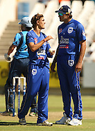 Michael Rippon gets some advice from Justin Kemp before his bowling spell during the first leg of the semi-final in the Standard Bank Pro20 series between the Nashua Mobile Cape Cobras and the Nashua Titans played at Sahara Park Newlands in Cape Town, South Africa on 27 February 2011. Photo by Jacques Rossouw/SPORTZPICS