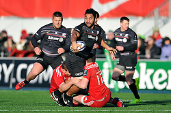 Billy Vunipola of Saracens looks to offload the ball - Photo mandatory by-line: Patrick Khachfe/JMP - Mobile: 07966 386802 17/01/2015 - SPORT - RUGBY UNION - London - Allianz Park - Saracens v Munster - European Rugby Champions Cup