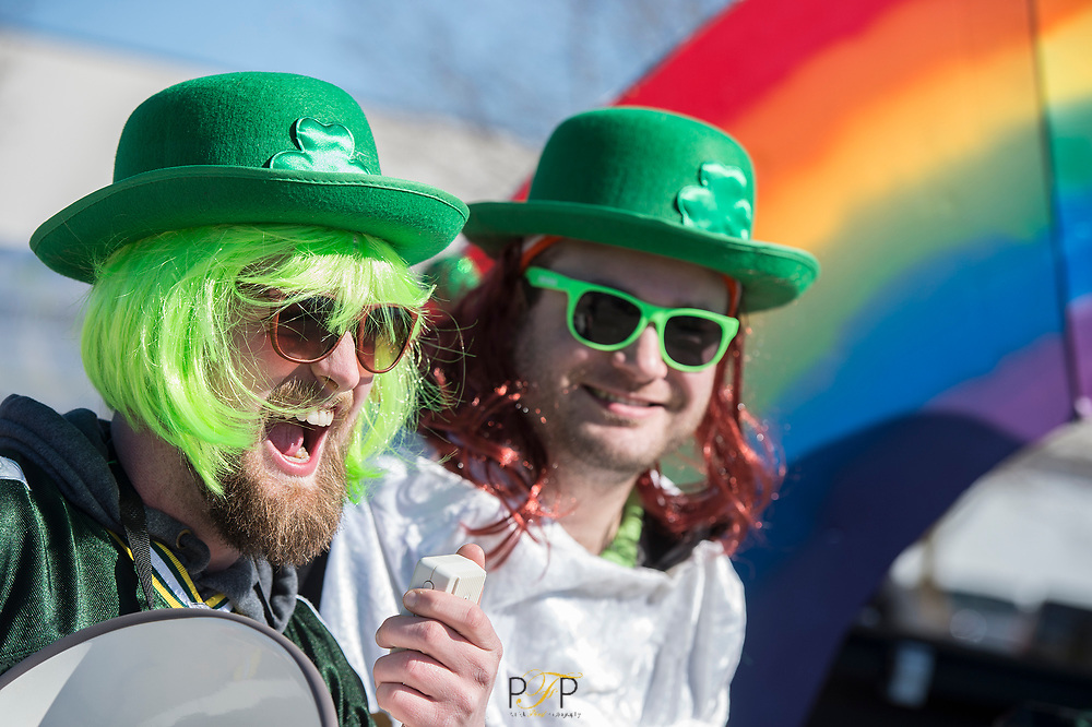 George McEnroe (left) and Bob Crist of Fond du Lac, warm up as they prepare to be in the O'Davies Pub float for the St. Patrick's Day parade in Fond du Lac. Saturday, March 17,  2018, Patrick Flood Photography