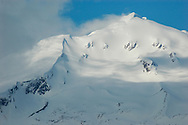 Clouds roll in across this impressive mountain landscape in Alaska.