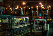 Railway Stations at night. About 8pm, Broadmeadows railway station, a large group of people wait on the outbound platform. Red sodium vapour lamps light up the background. Pic By Craig Sillitoe CSZ/The Sunday Age The Age iPad App.5/8/2011 This photograph can be used for non commercial uses with attribution. Credit: Craig Sillitoe Photography / http://www.csillitoe.com<br />