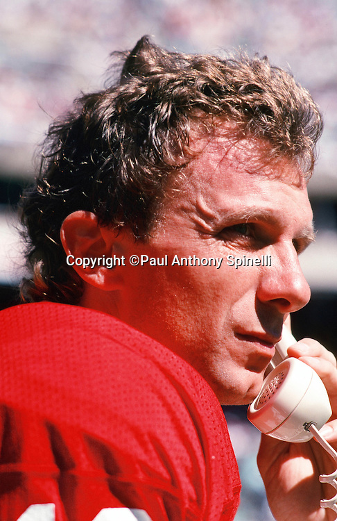 San Francisco 49ers quarterback Joe Montana (16) talks on the sideline phone to coaches in the press box level during the NFL football game against the Philadelphia Eagles on Sept. 24, 1989 in Philadelphia. The 49ers won the game 38-28. (©Paul Anthony Spinelli)