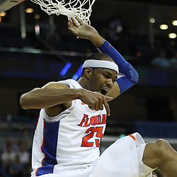 Mar 26, 2011; New Orleans, LA; Florida Gators forward Alex Tyus (23) celebrates after a dunk against the Butler Bulldogs during the second half of the semifinals of the southeast regional of the 2011 NCAA men's basketball tournament at New Orleans Arena.   Mandatory Credit: Derick E. Hingle