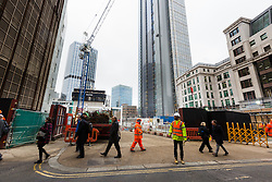 "© Licensed to London News Pictures. 10/03/2016. London, UK. Construction at the site of 22 Bishopsgate in London, seen here opposite the Baltic Exchange. If completed, the 62-storey, 295 meter glass and steel tower would become the City of London's tallest ever skyscraper, standing three times the height of Big Ben. But the scheme is under threat following ""right-to-light"" legal discussions with local residents, heritage groups and the owners of neighbouring properties including Tower 42, the Baltic Exchange and St Helen's church. Photo credit : Vickie Flores/LNP"