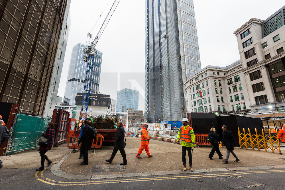 """© Licensed to London News Pictures. 10/03/2016. London, UK. Construction at the site of 22 Bishopsgate in London, seen here opposite the Baltic Exchange. If completed, the 62-storey, 295 meter glass and steel tower would become the City of London's tallest ever skyscraper, standing three times the height of Big Ben. But the scheme is under threat following """"right-to-light"""" legal discussions with local residents, heritage groups and the owners of neighbouring properties including Tower 42, the Baltic Exchange and St Helen's church. Photo credit : Vickie Flores/LNP"""