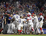 May 12, 2017 - Arlington, TX, USA - Texas Rangers third baseman Joey Gallo (13) gets mobbed at the plate by his teammates after a three-run home run in the ninth inning to beat the Oakland Athletics 5-2 on Friday, May 12, 2017 at Globe Life Park in Arlington, Texas. (Credit Image: © Richard W. Rodriguez/TNS via ZUMA Wire)