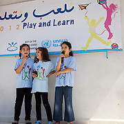 Girls performing to their parents in Rashidieh refugee camp after a week of Play and Learn with Naba'a. Developmental Action Without Borders(Naba'a) work in Palestinian refugee camps across Lebanon to help children in the camps.  The camps are densely over-crowded and many of the children are 4th generation refugees living in Lebanon with no citizenship or rights and under immense pressure. Naba'a is a mix of Palestinians and Lebanese and aim to give children a sense of security and freedom to express their needs and rights.Naba'a operates in communities governed by a multitude of political parties and religious groups and Naba'a keeps a strict independed line from any affiliation with any groups.