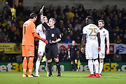 Burton Albion goalkeeper Stephen Bywater (1) receives a yellow card and is booked for pulling down the shorts of Leeds United midfielder Eunan O'Kane (14) during the EFL Sky Bet Championship match between Burton Albion and Leeds United at the Pirelli Stadium, Burton upon Trent, England on 26 December 2017. Photo by Richard Holmes.