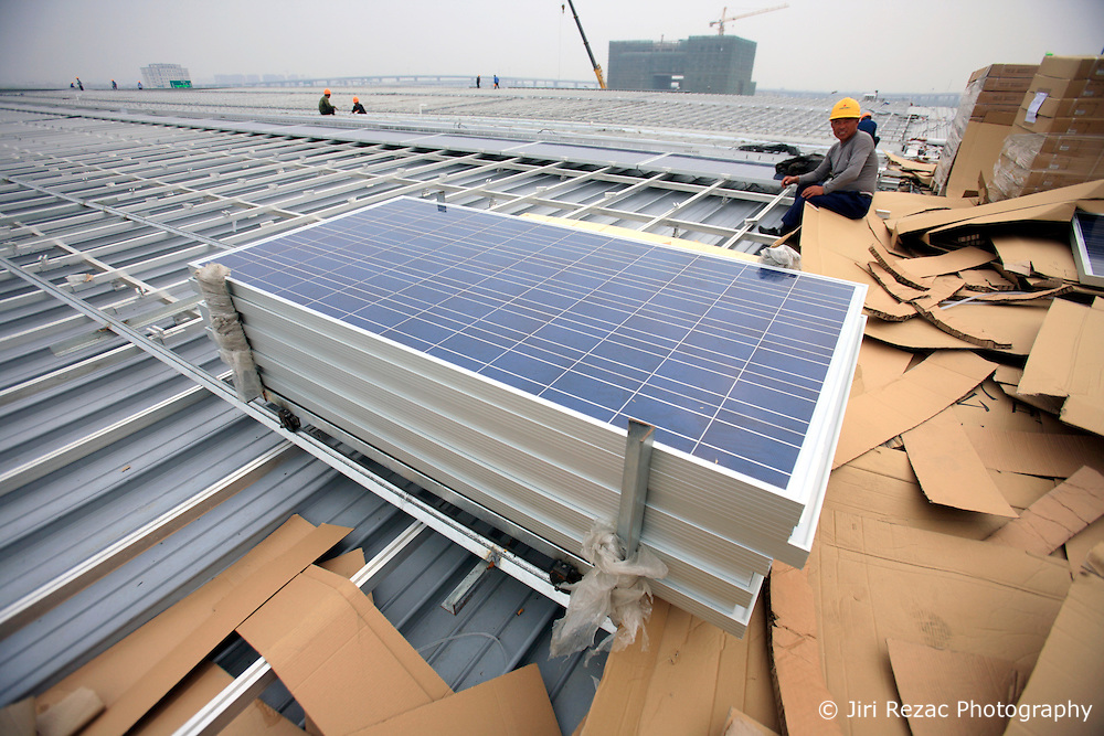 CHINA SHANGHAI HONGQIAO 19MAY10 - Installation of solar photovoltaic panels on the roofs of the Hongqiao Passenger Rail Terminal in Shanghai, China. There are a total of 23000 solar panels planned for the CECIC-funded project, each panel with a production capacity of 280 KWh to feed into the electricity grid...jre/Photo by Jiri Rezac..© Jiri Rezac 2010