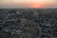 The sun sets behind destroyed buildings in the west side of Mosul, Iraq on Tuesday, July 11, 2017. The 9-month fight to defeat the Islamic State group in Mosul ended in a crescendo of bombardment that damaged or destroyed a third of its historic Old City in just three weeks. The cost of uprooting the militants was the destruction of large swaths of Iraq's second largest city, leaving a population that is displaced, exhausted and potentially embittered if there is no reconstruction. (AP Photo/Felipe Dana)