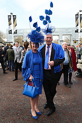 © Licensed to London News Pictures. 09/04/2016. Liverpool, UK. A couple wear matching attire on Grand National day of the Grand National 2016 at Aintree Racecourse near Liverpool. The race, which was first run in 1839, is the most valuable jump race in Europe. Photo credit : Ian Hinchliffe/LNP