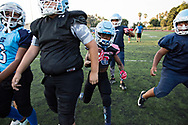 """The Hub City TarHeels U-10 team practices their routes, with a hole being made for Maxwell """"Bunchie"""" Young, 10, to break through with his speed."""