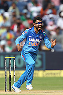 Ravindra Jadeja celebrates the wicket of Phillip Hughes of Australia during the first Star Sports Series One Day International (ODI) between India and Australia held at the Subrata Roy Sahara Stadium, Pune on the 13th October 2013<br /> <br /> Photo by Ron Gaunt - BCCI - SPORTZPICS  <br /> <br /> Use of this image is subject to the terms and conditions as outlined by the BCCI. These terms can be found by following this link:<br /> <br /> http://sportzpics.photoshelter.com/gallery/BCCI-Image-terms-and-conditions/G00004IIt7eWyCv4/C0000ubZaQCkIRgQ
