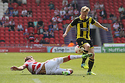 Doncaster Rovers defender Mitchell Lund (2)  tackles Burton Albion midfielder on loan from Birmingham City, Mark Duffy (21)  during the Sky Bet League 1 match between Doncaster Rovers and Burton Albion at the Keepmoat Stadium, Doncaster, England on 8 May 2016. Photo by Simon Davies.