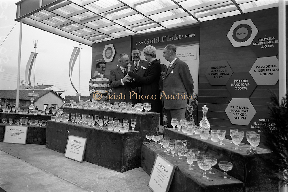 "08/05/1965<br /> 05/08/1965<br /> 08 May 1965<br /> The 1965 Gold Flake Meeting at Leopardstown Racecourse, Co. Dublin. Image shows Mrs D.R. Mott, wife of the Managing Director of Wills of Dublin and Cork, presenting the Trophy  for the Wills Gold Flake Stakes to Mr M.V. (Vincent) O'Brien, Trainer, who accepted it on behalf of the Countess de la Valdeme, who's ""Donato"" won the race. Also in the picture are (from left) Jack M. Purtell (Jockey) Mr. D.R. Mott and Mr Fred Clarke, Managing Director of Leopardstown Club. Note the Waterford Glass Crystal Service sets presented to the winning owner, trainer and jockey."