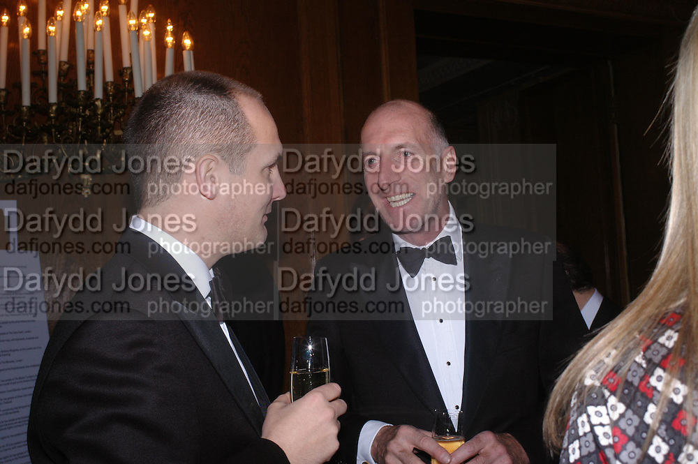 Paul Falukan and  Richard Strange. Conde Nast Traveller Tsunami Appeal dinner. Four Seasons  Hotel. Hamilton Place, London W1. 2 March 2005. ONE TIME USE ONLY - DO NOT ARCHIVE  © Copyright Photograph by Dafydd Jones 66 Stockwell Park Rd. London SW9 0DA Tel 020 7733 0108 www.dafjones.com