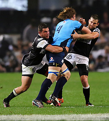 Keegan Daniel (r) and Franco Marais of the Sharks tackle RG Snyman during the Currie Cup match between the The Sharks and The Blue Bulls held at King's Park, Durban, South Africa on the 27th August 2016<br /> <br /> Photo by:   Anesh Debiky / Real Time Images