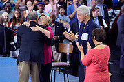 Democratic presidential nominee Hillary Clinton with her husband Bill (2nd R) hugs her running mate Time Kaine (L) at a campaign kickoff rally after the Democratic National Convention in Philadelphia July 29, 2016. At right is Kaine's wife Anne Holton. REUTERS/Rick Wilking