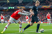 Arsenal defender Calum Chambers (21) shoves Eintracht Frankfurt defender Martin Hinteregger (13) during the Europa League match between Arsenal and Eintracht Frankfurt at the Emirates Stadium, London, England on 28 November 2019.