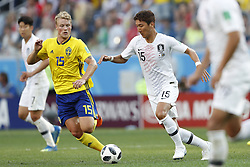 (L-R) Oscar Hiljemark of Sweden, Wooyoung Jung of Korea Republic during the 2018 FIFA World Cup Russia group F match between Sweden and Korea Republic at the Novgorod stadium on June 18, 2018 in Nizhny Novgorod, Russia
