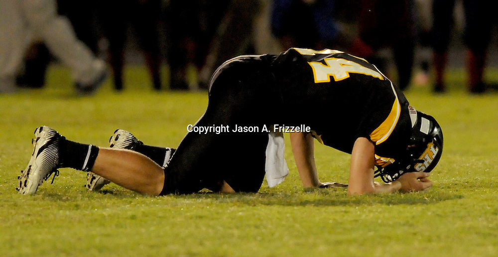 Topsail High School's Nick Altilio is slow to get up after a hit in the second quarter against Pender High School Friday August 30, 2013 at Topsail High School. (Jason A. Frizzelle) This collection of images is from the 2013 High School Football in the Cape Fear region.