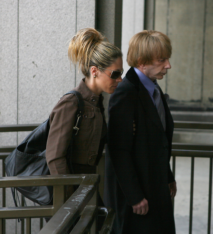 LOS ANGELES, CA - JUNE 25: .Music producer PHIL SPECTOR and his wife RACHELLE MARIE SPECTOR arrive at the Los Angeles Criminal Courts building flanked by security guards on June 25th, 2007 in Los Angeles, CA, for trial. Spector, 67, is accused of fatally shooting Lana Clarkson, a 40-year-old House of Blues hostess, in the foyer of his Alhambra mansion during the early hours of Feb. 3, 2003. He maintains Clarkson's death was a suicide.