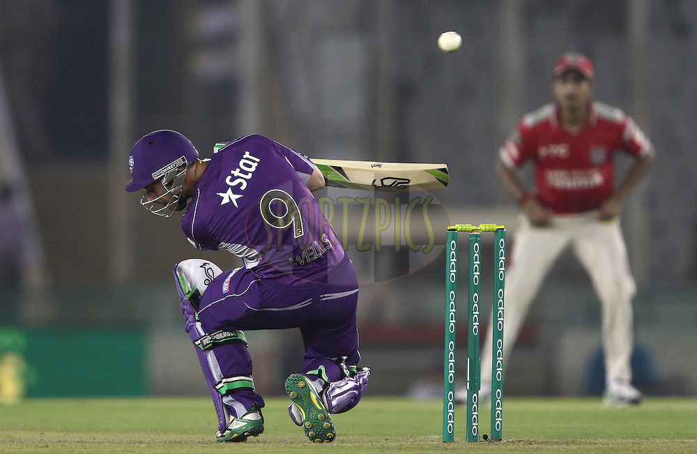 Jon Wells of the Hobart Hurricanes ducks under a short delivery during match 2 of the Oppo Champions League Twenty20 between the Kings XI Punjab and the Hobart Hurricanes held at the Punjab Cricket Association Stadium, Mohali, India on the 18th September 2014<br /> <br /> Photo by:  Shaun Roy / Sportzpics/ CLT20<br /> <br /> <br /> Image use is subject to the terms and conditions as laid out by the BCCI/ CLT20.  The terms and conditions can be downloaded here:<br /> <br /> http://sportzpics.photoshelter.com/gallery/CLT20-Image-Terms-and-Conditions-2014/G0000IfNJn535VPU/C0000QhhKadWcjYs