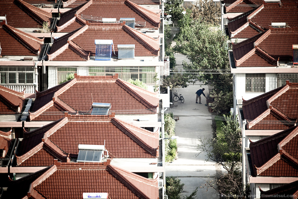 "Newer homes in the ""New City,"" part of the expansion of Yangzhou, China, a suburb city of Shanghai and major producer of photovoltaic cells for the renewable energy solar power industry."
