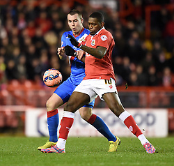 Bristol City's Jay Emmanuel-Thomas keep the ball away from Doncaster Rovers Luke McCullough during the FA Cup third round replay between Bristol City and Doncaster Rovers at Ashton Gate on January 13, 2015 in Bristol, England. - Photo mandatory by-line: Paul Knight/JMP - Mobile: 07966 386802 - 13/01/2015 - SPORT - Football - Bristol - Ashton Gate Stadium - Bristol City v Doncaster Rovers - FA Cup third round replay