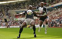 Fotball<br /> England 2005/2006<br /> Foto: SBI/Digitalsport<br /> NORWAY ONLY<br /> <br /> Reading Football Club v Tottenham Hotspurs<br /> Friendly. <br /> Madejski Stadium.<br /> 30/07/2005<br /> <br /> Spurs Jermain Defoe (right)  tussles with Reading's Ibrahima Sonko in the first half.