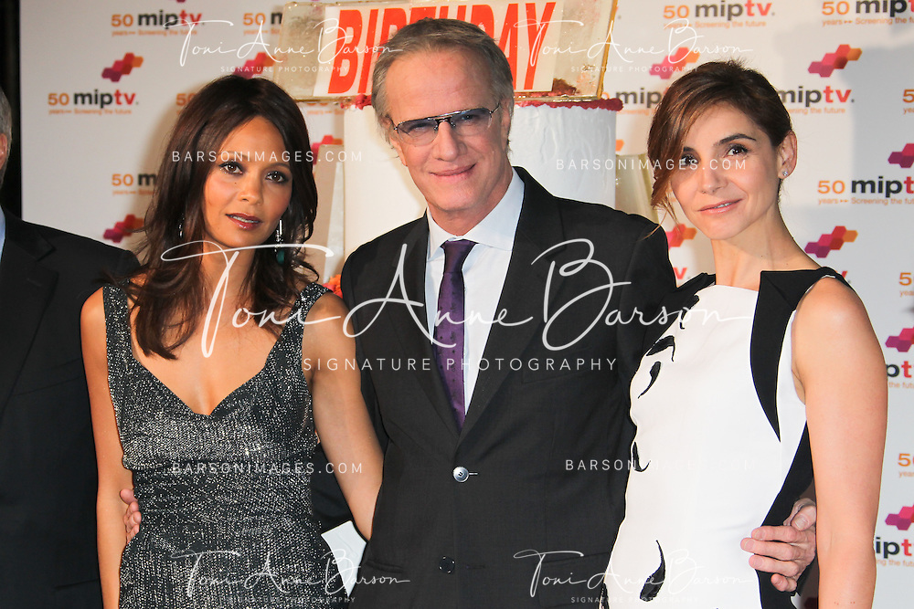 CANNES, FRANCE - APRIL 08: Thandie Newton, Christophe Lambert and Clotilde Courau arrive at the MIPTV 50th Anniversary : Opening Party at the Martinez Hotel on April 8, 2013 in Cannes, France.  (Photo by Tony Barson/Getty Images)