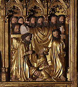Funeral of the Virgin, with the apostles carrying her body and below, Jews praying to St Peter, from the Altarpiece of the Virgin, 1430-40, in the Eglise de Saint-Roch, Ternant, Nievre, Burgundy, France. The altarpiece was commissioned by Philippe de Ternant and his wife Isabeau de Roye, and depicts 7 scenes of the Life of the Virgin, both painted and sculpted, including the Annunciation, Dormition and Glorification. It was made by Brabant and Flemish workshops in painted and gilded carved wood. The altarpiece has been restored many times and is listed as a historic monument. Picture by Manuel Cohen